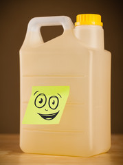 Post-it note with smiley face sticked on gallon