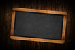 Blank Slate on Wooden Background