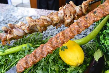 Raw meat on skewers of vegetables