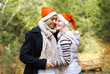 Christmas and people concept - happy pretty couple in love again