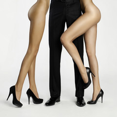 Male legs surrounded by women