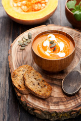 Pumpkin soup on wooden board
