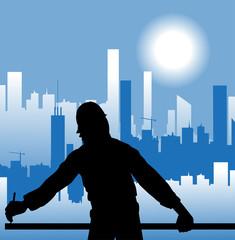 operaio che lavora e città sullo sfondo