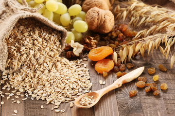 oatmeal in a sac, ears of oats, dried apricots, raisins, grapes,