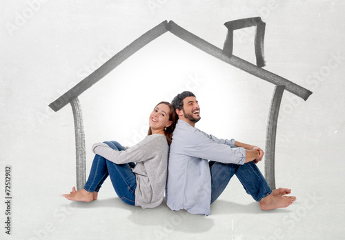 young couple dreaming of new house in real state concept