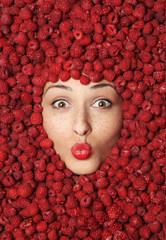 beautiful girl in raspberries