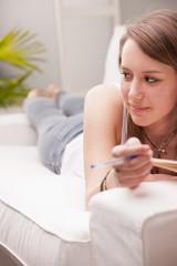 Girl studying on a sofa