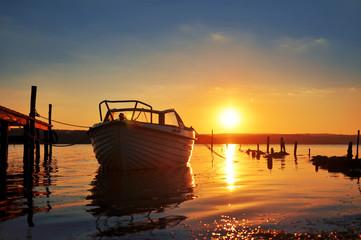 Boat at sunset beach