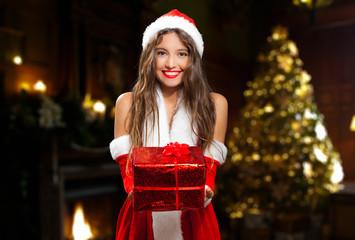 Beautiful Santa Claus woman giving you a gift