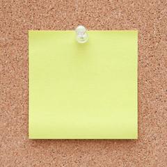 Yellow note on a corkboard