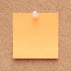 Orange note on a corkboard