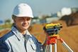 surveyor worker with level