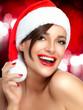 Merry Christmas. Happy Girl in Santa Hat. Beautiful Big Smile