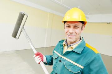 flooring worker with roller