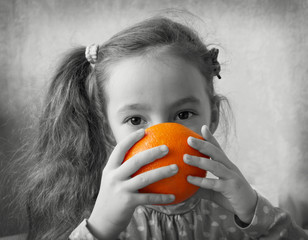 Cute girl play with oranges