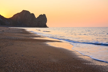 Morning on the beach at Durdle Door in Dorset, UK.