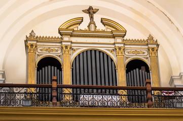 Pipe organ inside catholic church