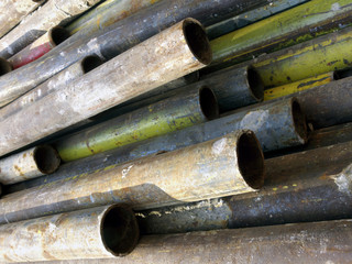Rusty old pipes for building scaffold