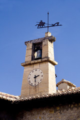 Vane and watch on a belfry