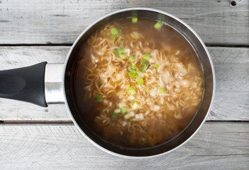 Asian instant noodle cooked in a saucepan