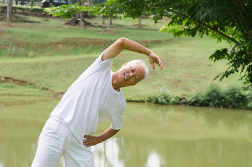 Retired Asian senior man exercising in park