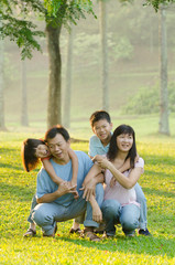asian family enjoying outdoor at the park