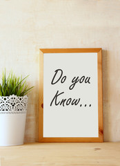 "white drawing board with the question "" do you know"" written on"