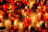 Many burning candles in the cemetery at night on the occasion me