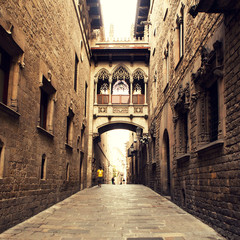 Gothic street with arch in Barcelona close to Cathedral.