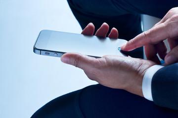 Businessman sit leisurely using smartphone