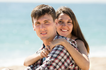Portrait of a happy couple resting on the beach