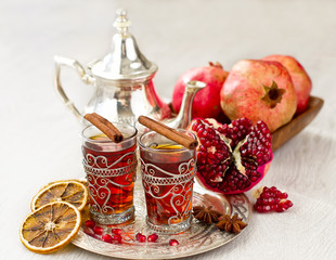 Traditional arabic tea with metal teapot and glasses