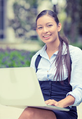 happy business woman with computer outside  looking at camera