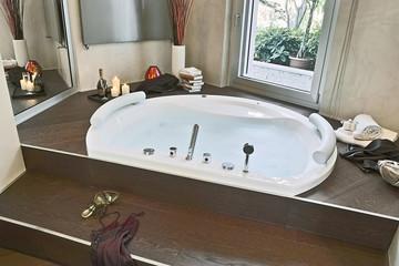 close up of a bathtub full of water in a modern bathroom