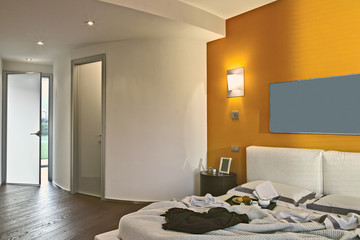 interior view of a modern bedroom with wood floor