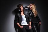 Fashion couple posing on grey studio background - 72534750
