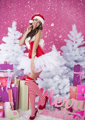 Sexy brunette woman in santa claus clothes