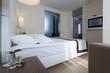 Interior of a luxury hotel bedroom with bathroom