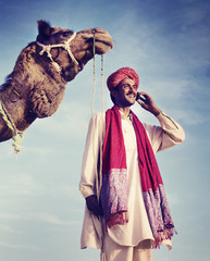 Indian Man On the Phone with Camel Concepts