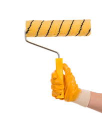 Hand holding a paint roller