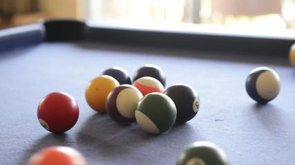 Footage of billiard balls break on a pool table