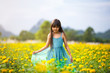 Little asian girl in flower fields
