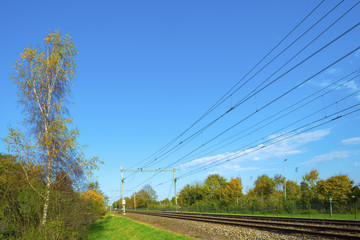 Railroad through the countryside at fall