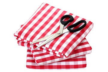 Folded fabric, gingham pattern, with a pair of scissors on it