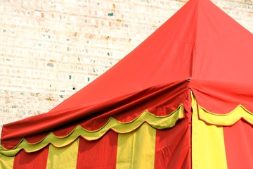 yellow and red lines tent near the wall of castle