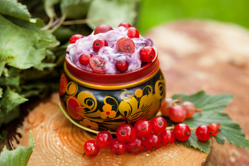 yogurt with red currants in a bowl of Russian folk