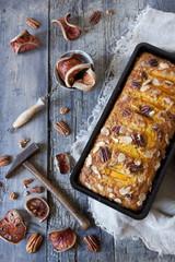 orange plumcake with pecan walnuts with dried orange slices
