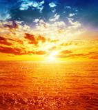 Fototapety good orange sunset over sea