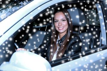 Beautiful young woman in car