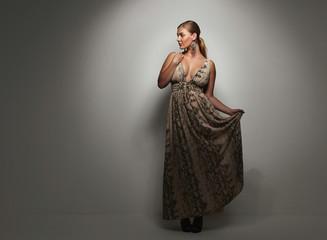Beautiful caucasian woman in an elegant cocktail dress